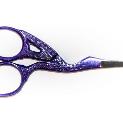 A QuilTak quilt basting tool.