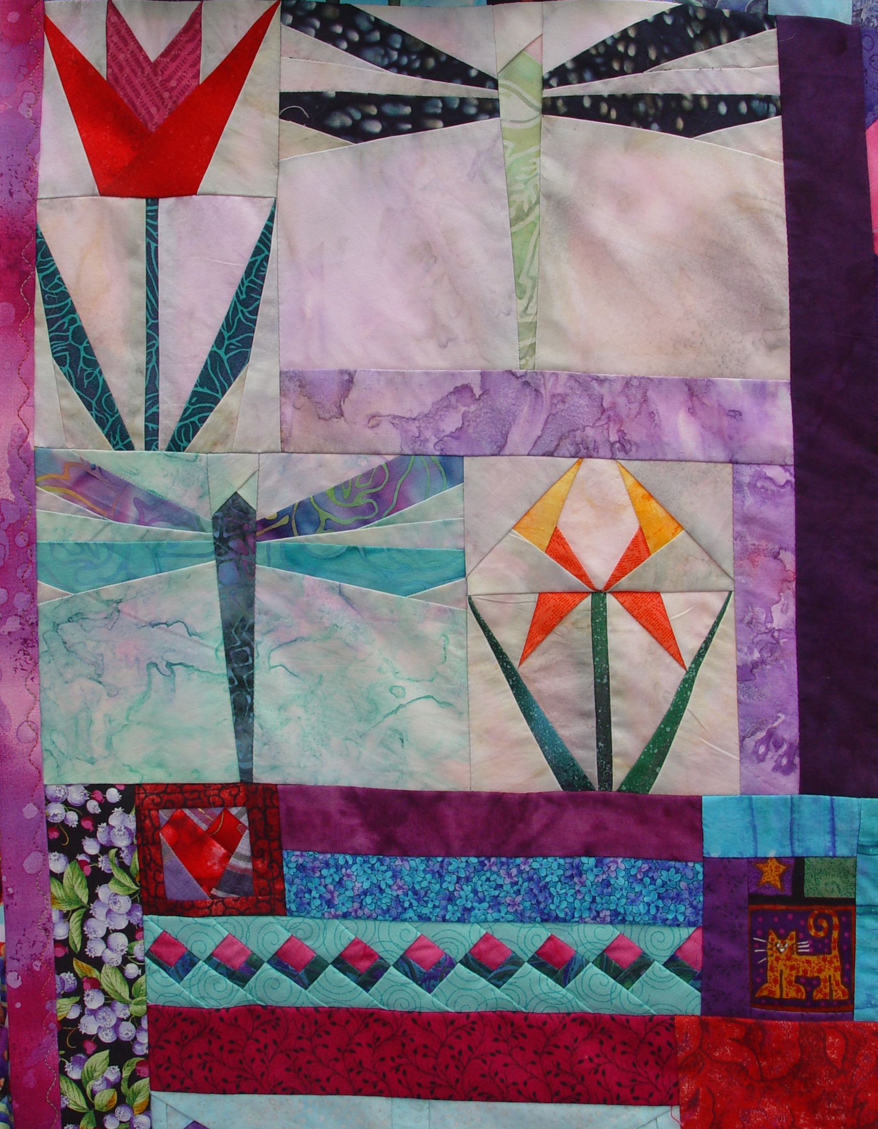 A quilt made using our QuilTak quilt basting tool.